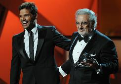 Placido Domingo, right, receives the Person of the Year award from Ricky Martin during the 11th Annual Latin Grammy Awards on Thursday in Las Vegas.